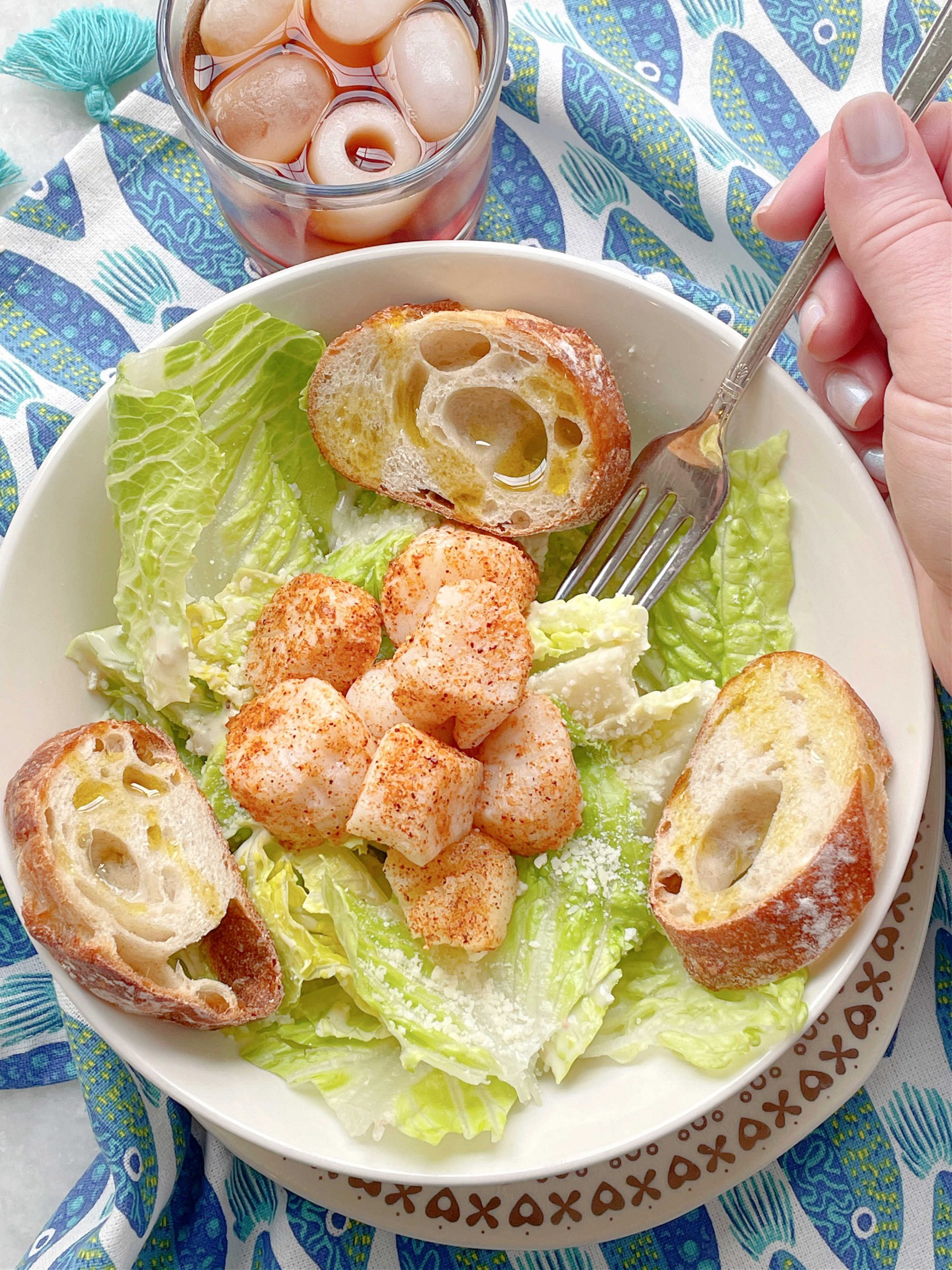 air fryer scallops served on a Caesar salad