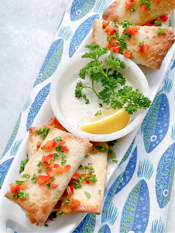 a platter full of air fryer feta cheese rolls