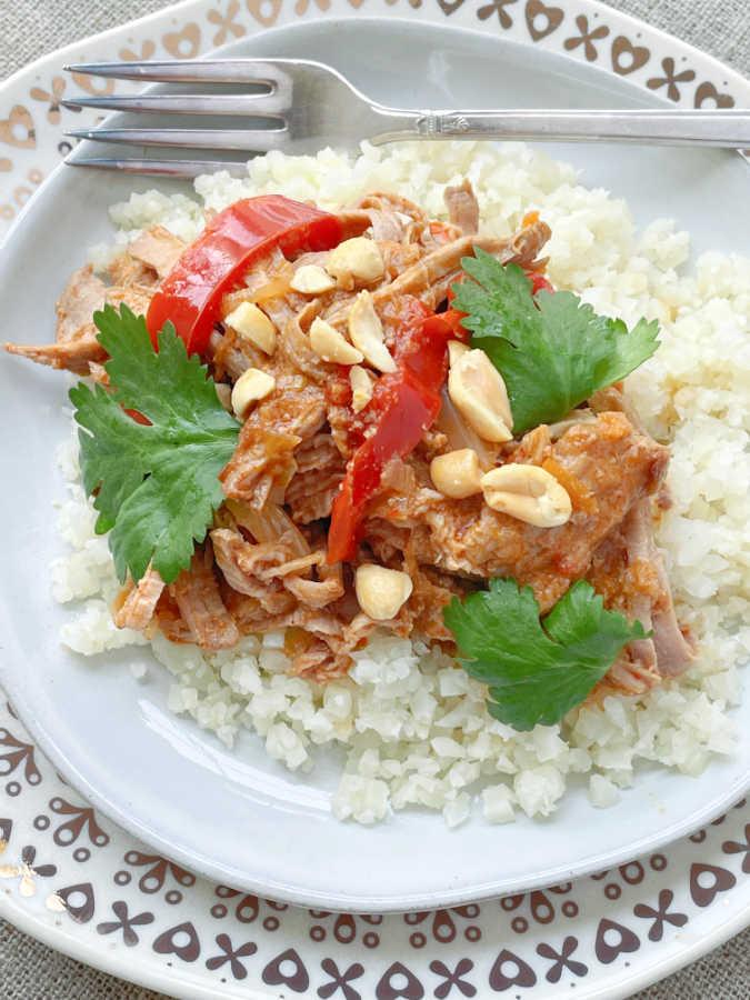 slow cooker satay pork served over cauliflower rice