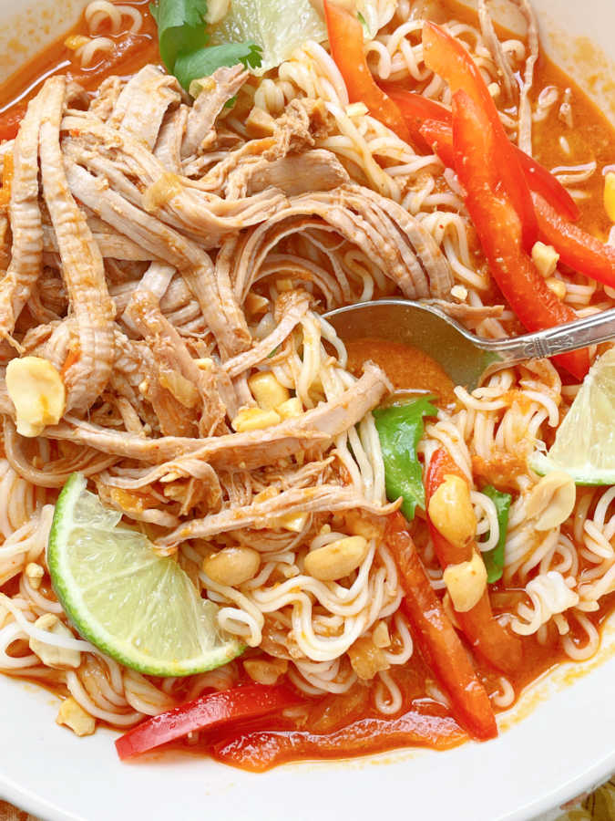 taking a bite of thai ramen