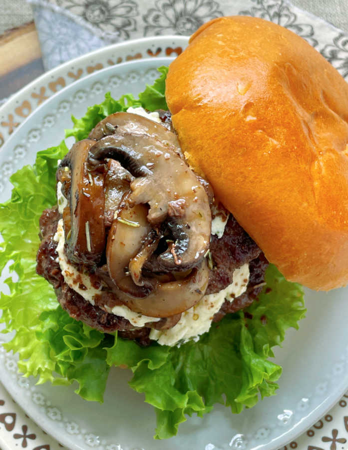 wagyu beef burger topped with sauteéd mushrooms